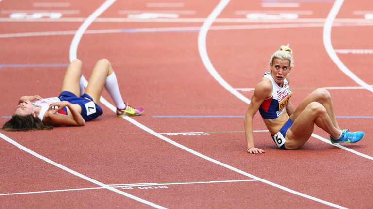Lynsey Sharp rests on the track next to Jessica Judd after 800m final