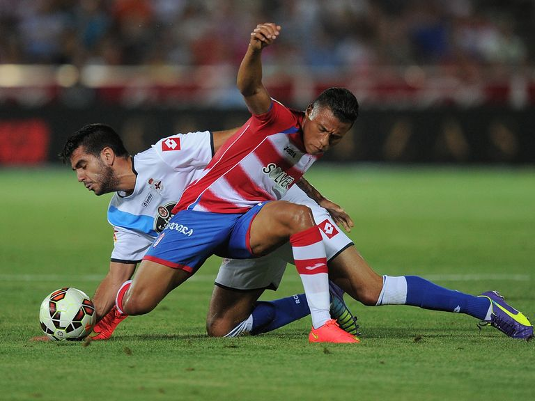Darwin Machis (R) of Granada CF battles for the ball against Pablo Insua of Deportivo La Coruna