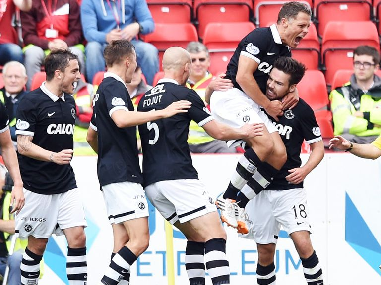 Dundee United celebrate after scoring during their enjoyable away trip to Aberdeen