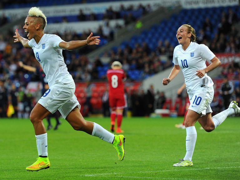 Lianne Sanderson (l) celebrates scoring England's fourth goal