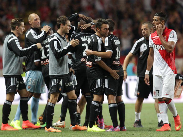 Lorient celebrate a 2-1 victory over Monaco