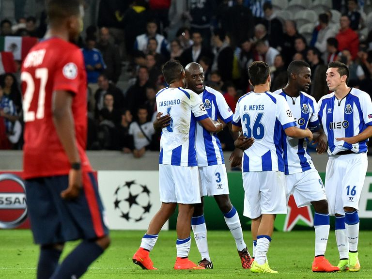 Porto's players celebrate at the end of the League play-off first leg at Lille