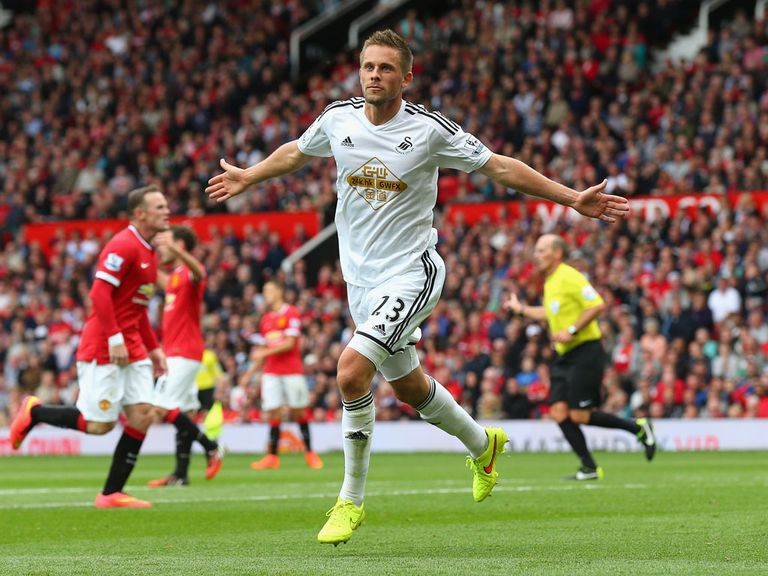 Gylfi Sigurdsson celebrates scoring Swansea City's winning goal