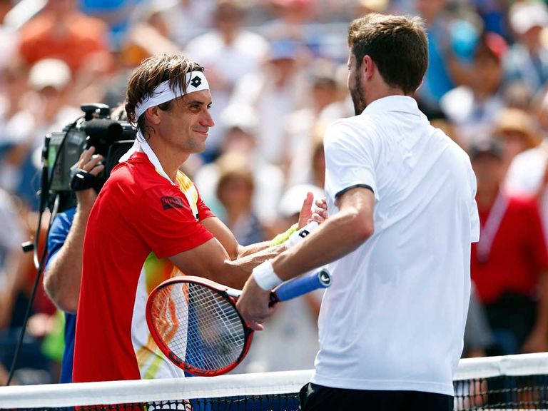 David Ferrer (left) was ousted by Gilles Simon