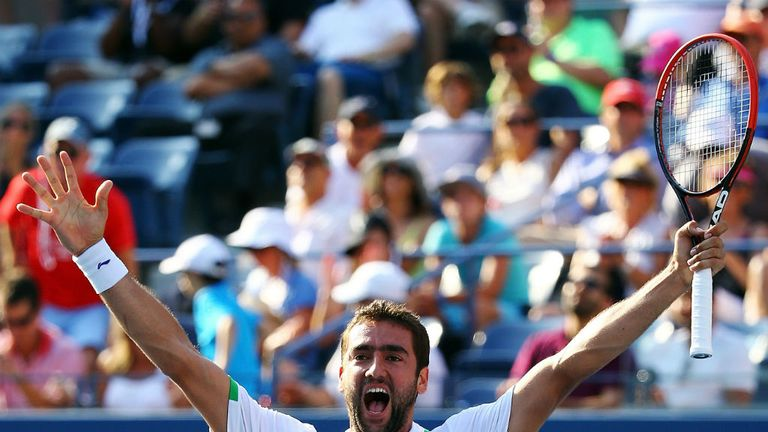 Marin Cilic: Raises his arms aloft in triumph after beating Tomas Berdych in straight sets