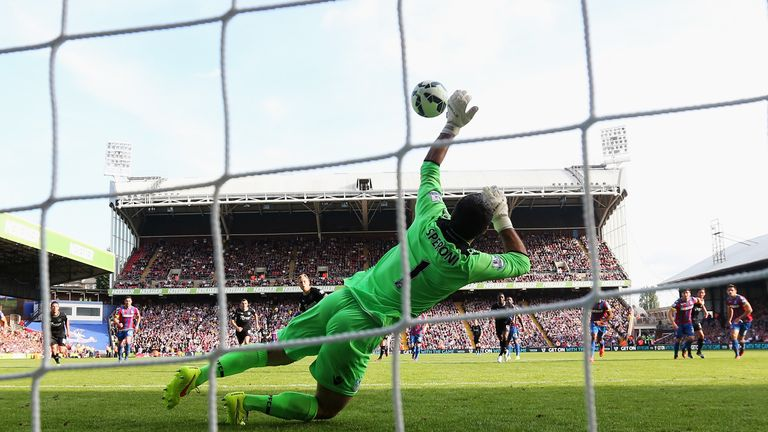 Julian Speroni saves Scott Arfield's penalty to deny Burnley their first win of the season