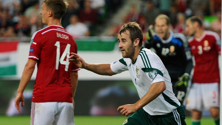 Niall McGinn: Celebrates after equalising