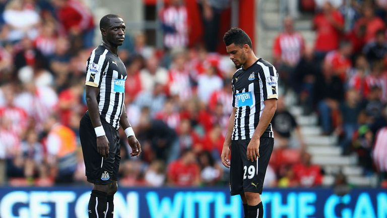 Moussa Sissoko and Emmanuel Riviere: Dejected after thrashing