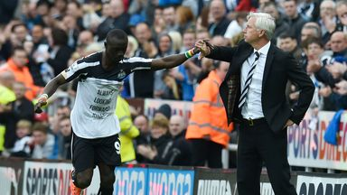 Papiss Cisse celebrates with Alan Pardew