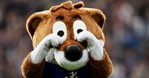 Filbert the Leicester City mascot mocks the Manchester United fans as the Foxes recover to beat the Red Devils 5-3