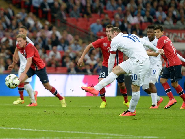 England's Wayne Rooney scores the only goal from the penalty spot