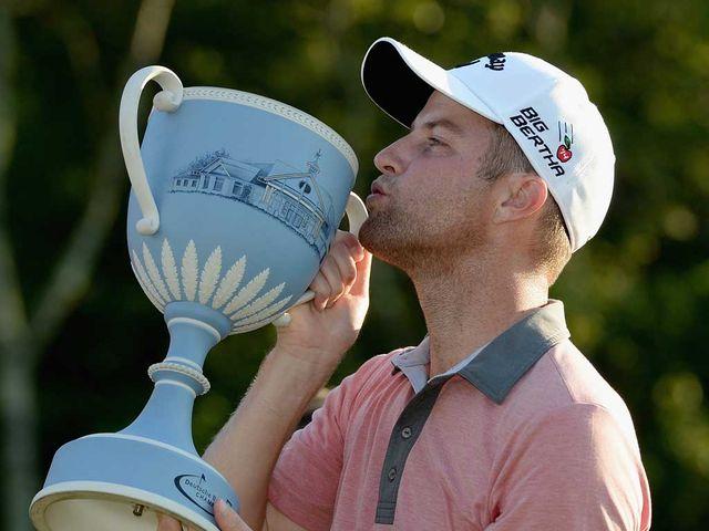 Chris Kirk gets his hands on the Deutsche Bank Championship trophy