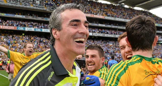 Donegal manager Jim McGuinness celebrates with his players after the win over Dublin