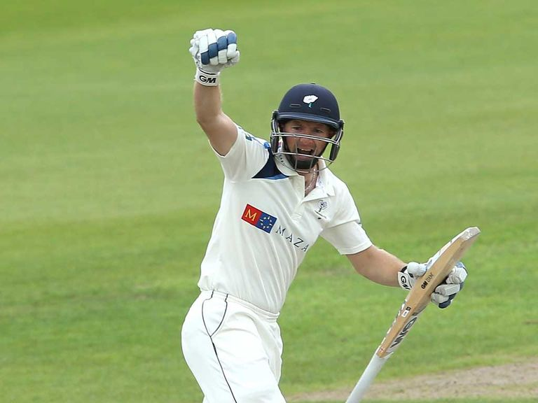 Adam Lyth of Yorkshire celebrates his century at Old Trafford