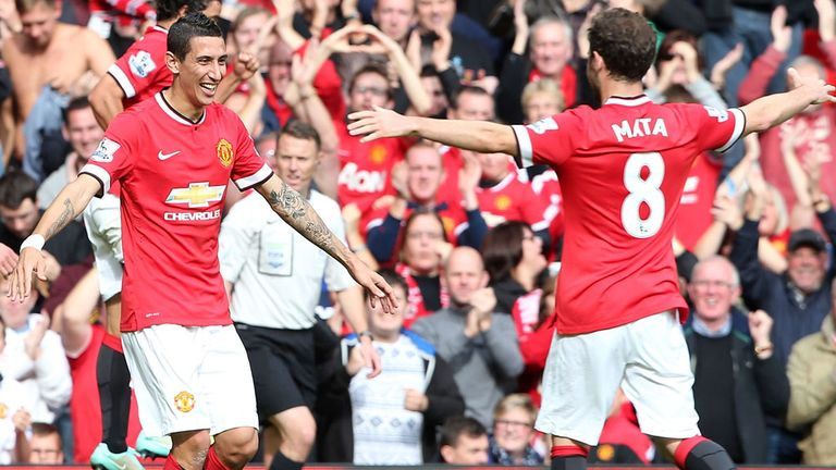 Angel di Maria celebrates with Juan Mata