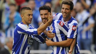 Deportivo's forward Toche (C) celebrates