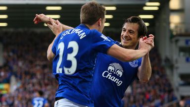 Everton defender Leighton Baines (R) celebrates with Seamus Coleman.