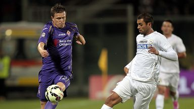 Josip Ilicic of ACF Fiorentina battles for the ball with Danilo of Udinese Calcio
