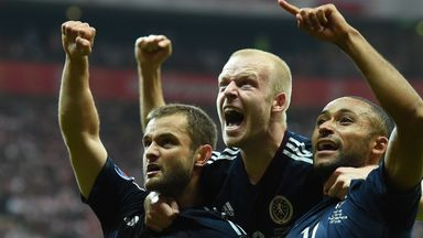 Shaun Maloney (left) celebrates with team-mates Steven Naismith (centre) and Ikechi Anya after equalising
