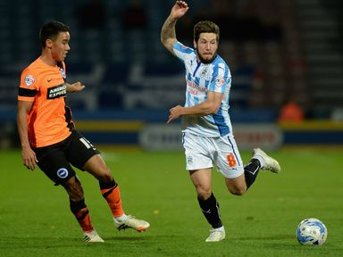 Huddersfield's Jacob Butterfield (right) vies with Adam Chicksen of Brighton