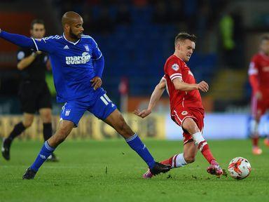 Ipswich striker David McGoldrick (left) challenges Cardiff's Craig Noone
