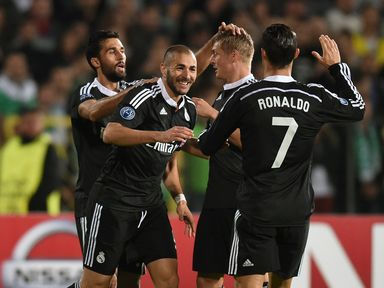 Real Madrid's Karim Benzema  is congratulated by teammates