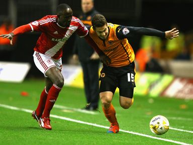 Tommy Rowe (right) tangles with Albert Adomah