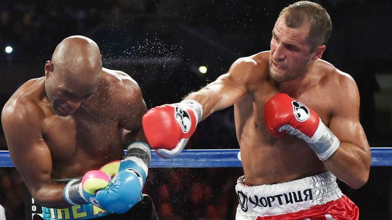 Sergey Kovalev punches Bernard Hopkins during their IBF, WBA, & WBO Light Heavyweight title fight at Boardwalk Hall Arena