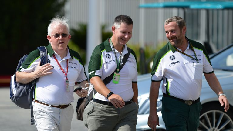 Caterham administrator and interim team boss Finbarr O¿Connell (L) makes his way into the Abu Dhabi paddock