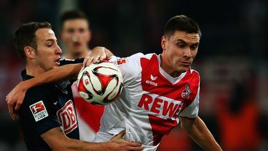 Jonas Hector is challenged by Roy Beerens