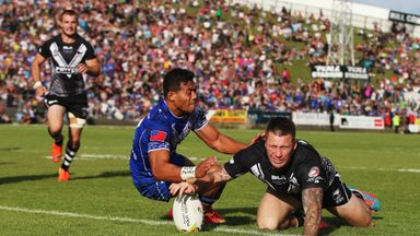 Shaun Kenny-Dowall dives over to score the vital New Zealand try