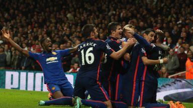United celebrate Wayne Rooney's goal at Arsenal