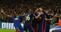Wayne Rooney: Mobbed after scoring United's second goal