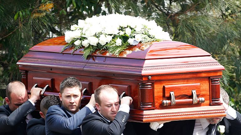 Australia captain Michael Clarke and Jason Hughes carry the coffin