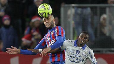Caen's Alaeddine Yahia (l) battles with Floyd Ayite