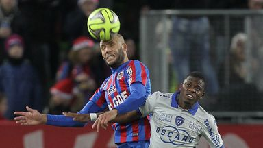 Caen's Alaeddine Yahia (left) vies for the ball with Bastia's midfielder Floyd Ayite (right)