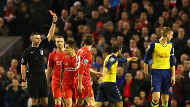 Fabio Borini of Liverpool is shown the red card by referee Michael Oliver