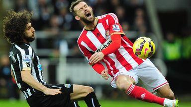 Newcastle's Fabricio Coloccini makes a rash challenge on Sunderland's Steven Fletcher during Sunday's Tyne-Wear derby