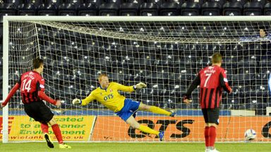 St Johnstone's Brian Graham (left) slots it home to put his side 1-0 up.