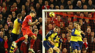 Martin Skrtel: Heads home as Per Mertesacker ducks