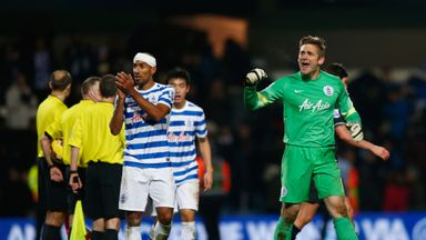 Robert Green celebrates with Karl Henry after QPR