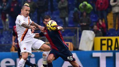 Stefano Sturaro is put under pressure by Radja Nianggolan