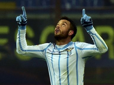 Felipe Anderson celebrates Lazio's opener at the San Siro