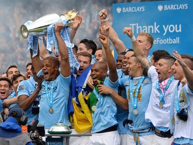 Manchester City celebrate with the Premier League trophy