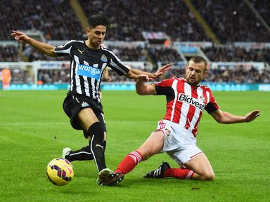 Ayoze Perez is tackled by Lee Cattermole