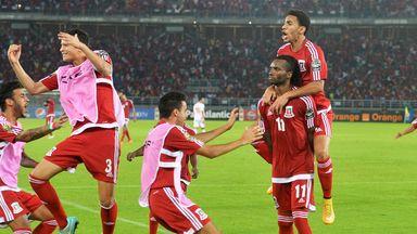 Javier Balboa (11) stays calm while his team mates celebrate