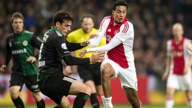 Ajax's Jairo Riedewald (right) vies for the ball with FC Groningen's Eric Botteghin