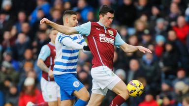 Michael Keane of Burnley is closed down by Adel Taarabt of QPR during Saturday