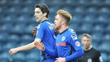 Rochdale's Peter Vincenti (l) misses out with an ankle injury