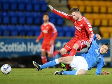 Aberdeen's David Goodwillie is chopped down by St Johnstone's Murray Davidson